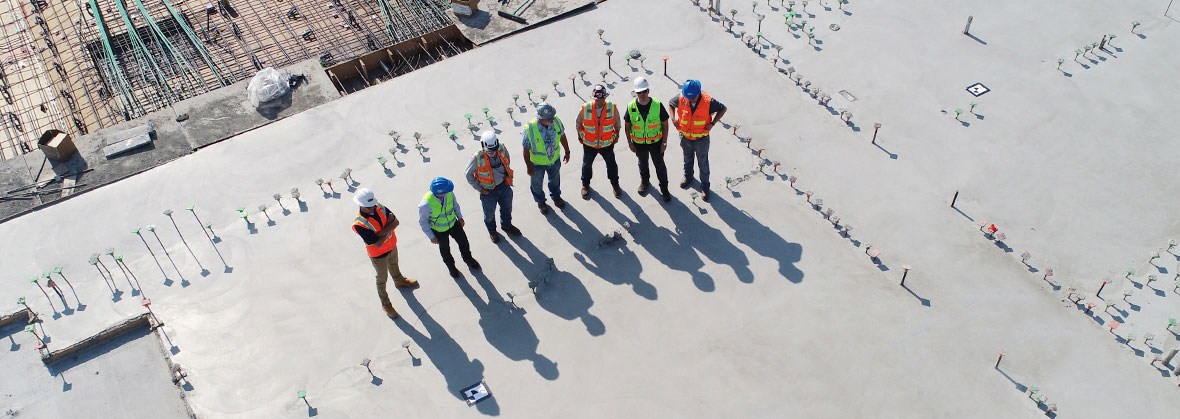 pre-shift safety meeting of workers at construction site